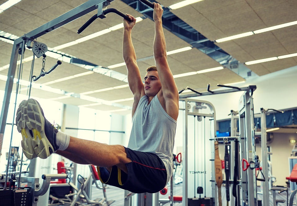 Man doing ab exercises on a pull-up bar