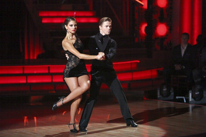 Maria Menounos and Derek Hough, dressed all in black, strike an intense pose on 'Dancing With the Stars.'