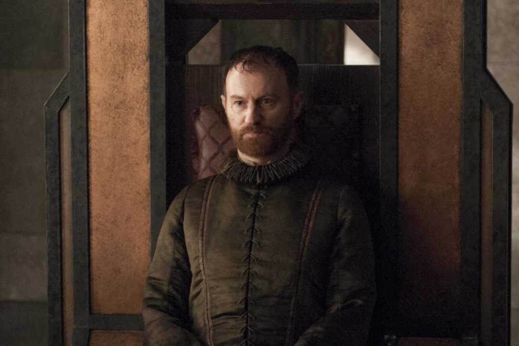 Mart Gatiss sitting in a large chair in Game of Thrones