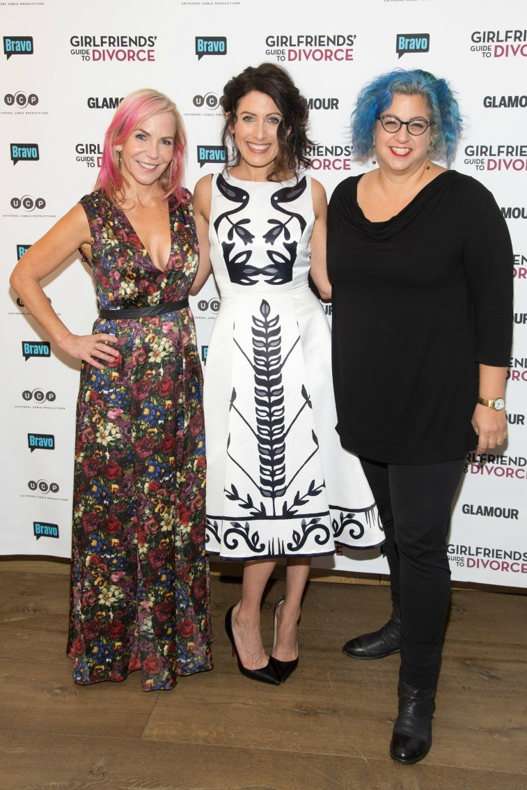 Marti Noxon, Lisa Edelstein, and Jenji Kohan in front of sign for Girlfriend's Guide to Divorce