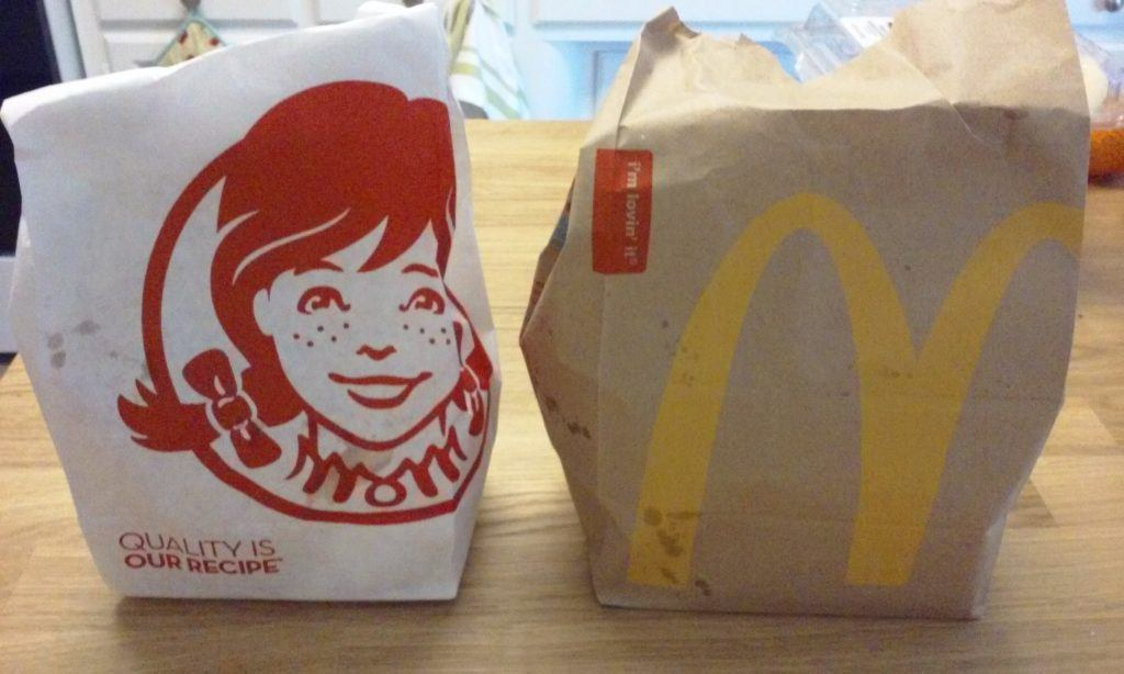 Bags of food from Wendy's and McDonald's