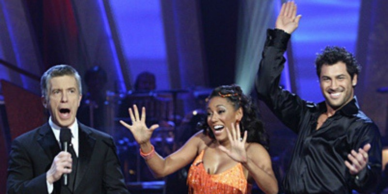 Mel B, Maksim Chmerkovskiy, and Tom Bergeron are celebrating while talking to the judges on Dancing with the Stars.