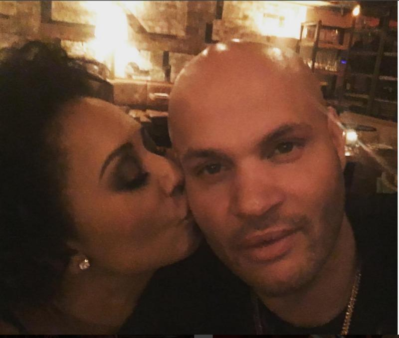 Mel B is kissing Stephen's cheek in a selfie.