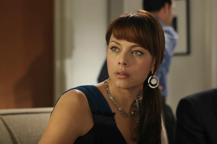 Melinda Clarke looks to the side as Julie Cooper on The O.C.