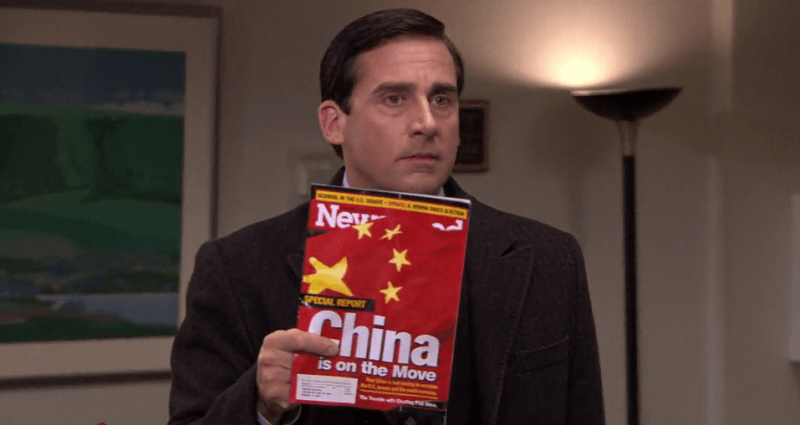 """Scene from """"The Office"""" with Michael Scott holding up magainze that says """"China is on the move"""""""