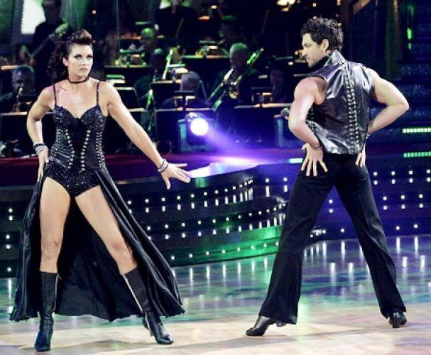Misty May-Treanor and Maksim Chmerkovskiy strike a pose in matching black leather-studded costumes on 'Dancing With the Stars.'