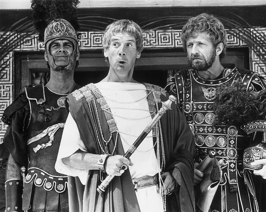 John Cleese as a centurion, Michael Palin as Pontius Pilate and Graham Chapman as Biggus Dickus in armor in black and white in Monty Python