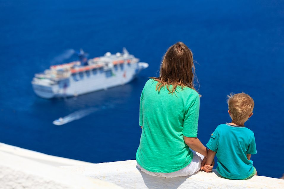 Mother and son looking at Santorini, Greece