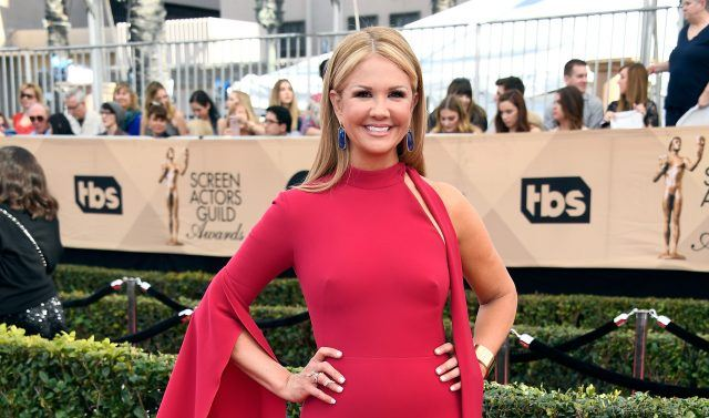 Nancy O'Dell poses on the red carpet wearing a red dress at the 2017 Screen Actors Guild Awards.