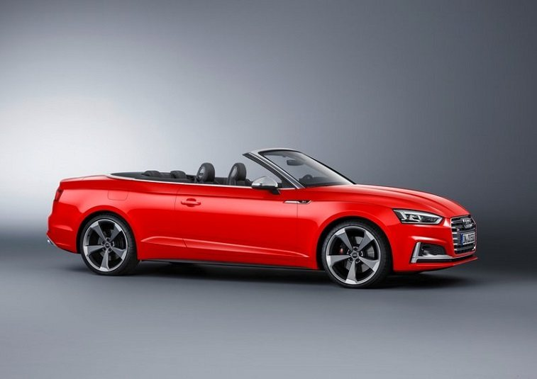 Red Audi S5 Cabriolet convertible with the top down