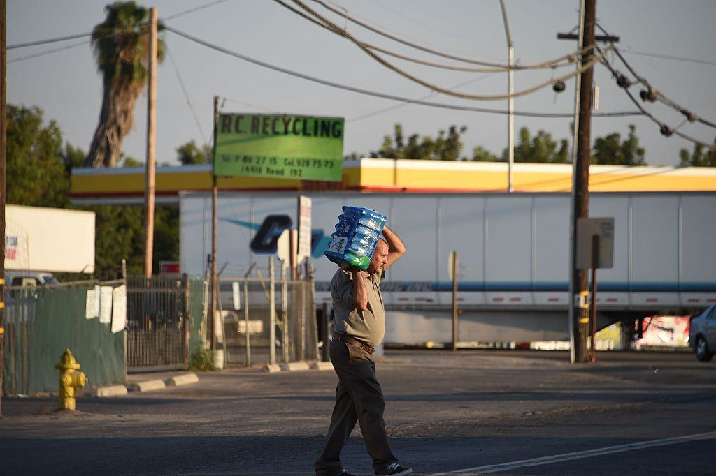 man carrying water jug