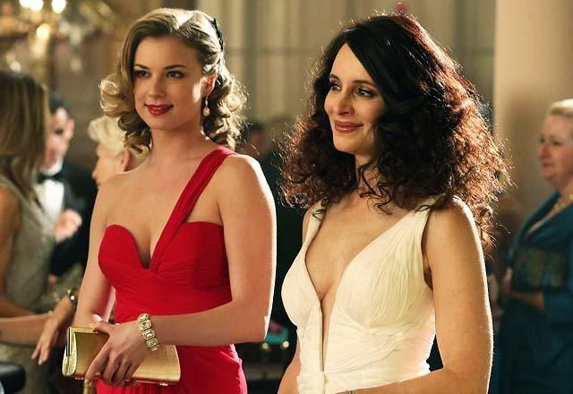 Emily and Victoria smile as they wear formal wear in a scene from ABC's series 'Revenge.'