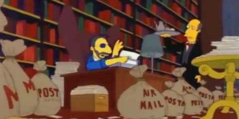 Ringo Starr is sitting at a desk writing on a typewriter and is surrounded by bags of fan mail on The Simpsons.