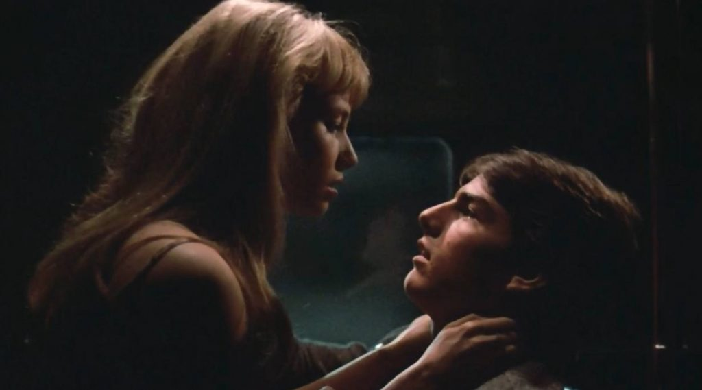 Rebecca De Mornay on top of Tom Cruise, on a subway train together