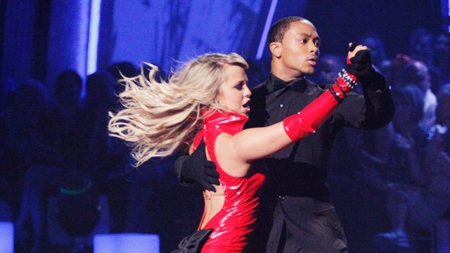 Chelsie Hightower wears a red rubber outfit and Romeo Miller wears all black as they dance on 'Dancing With the Stars.'