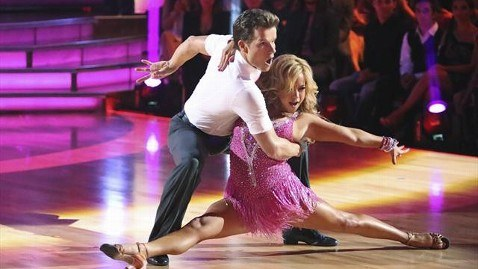 Sabrina Bryan does the splits while wearing a pink dress on 'Dancing With the Stars.'