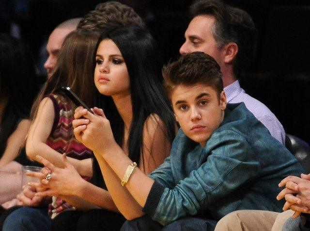 Justin Beiber and Selena Gomez watch the San Antonio Spurs and the Los Angeles Lakers game at Staples Center on April 17, 2012 in LA.