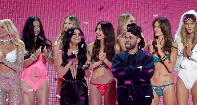 Candice Swanepoel, Adriana Lima, Behati Prinsloo, Romee Strijd, Alessandra Ambrosio, Kate Grigorieva, (Front Row L-R) Singer Selena Gomez, Lily Aldridge and Singer The Weeknd walk the runway during the 2015 Victoria's Secret Fashion Show at Lexington Avenue Armory on November 10, 2015 in New York City.