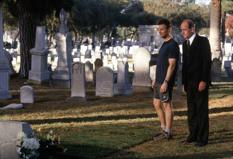 Actors Peter Krause and Richard Jenkins stand in a graveyard in a scene from 'Six Feet Under'