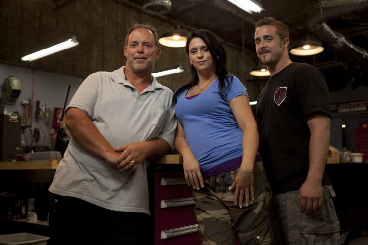 Will Hayden and his two co-stars pose in his shop Red Firearms in Sons of Guns