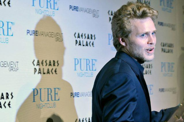 Spencer Pratt posing for paparazzi in front of backdrop advertising Pure Nightclub and Caesars Palace