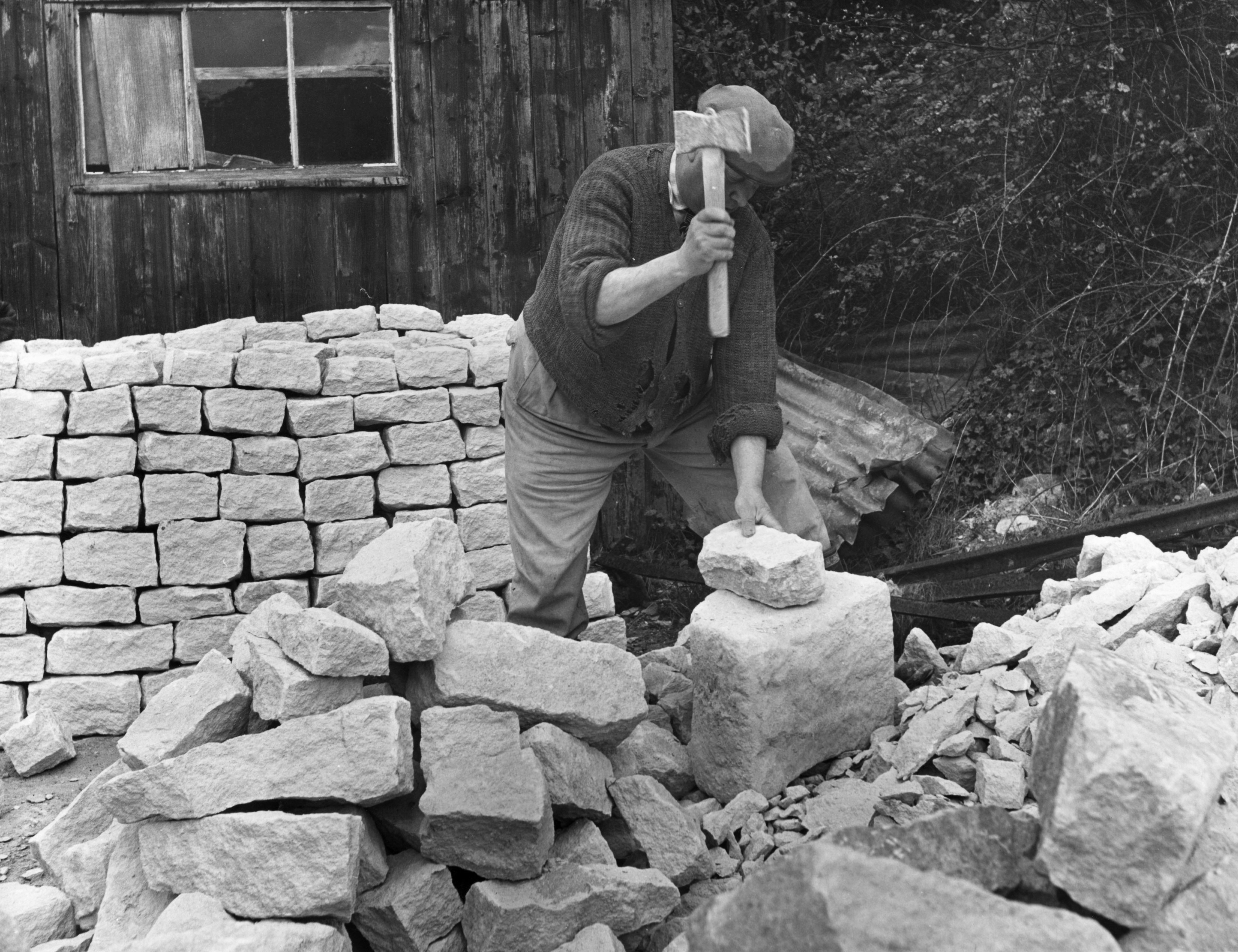 A mason shaping Cotswold stones