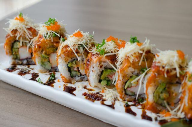 Sushi roll maki on a white plate.