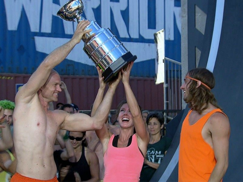 Team Party Time are holding up the trophy after their win on Team Ninja Warrior.