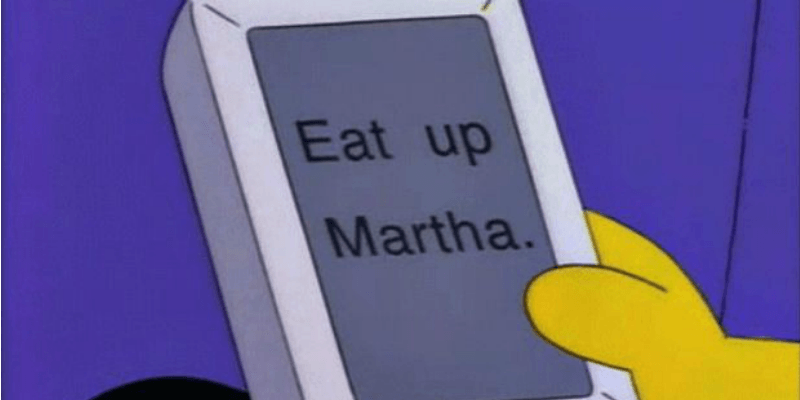"""Homer is holding the Newton device that has the words """"Eat up Martha"""" on it."""