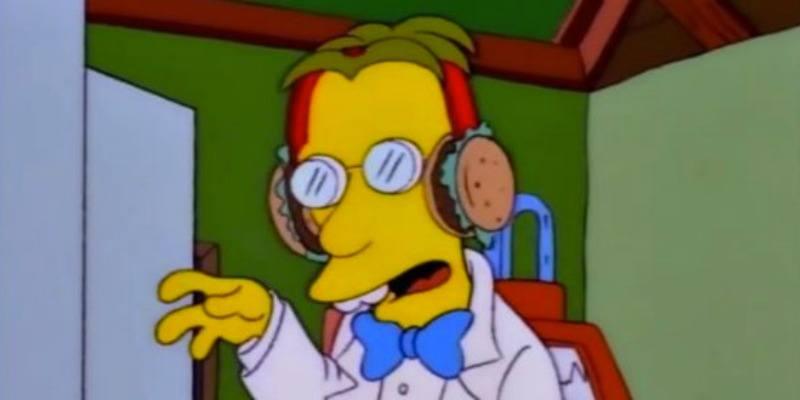 Professor Fink is wearing hamburger earmuffs.