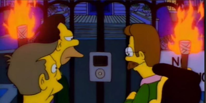 An angry mob with pitchforks are at a gate looking an intercom that looks like an iPod.