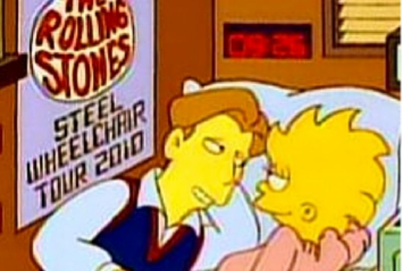 Lisa is lying on a bed and a boy. There is a Rolling Stones poster beside them.