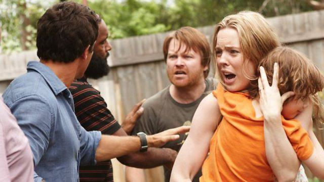 Rosie looks distraught as she clutches Hugo to her chest in the midst of an argument in a scene from 'The Slap.'