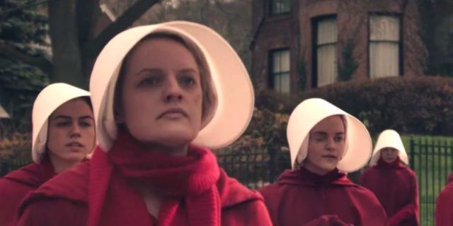 A group of women are wearing red gowns and white bonnets in 'The Handmaid's Tale'.