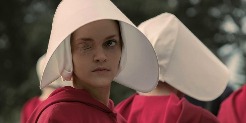 Janine looks to the side and has one eye sewed shut in The Handmaid's Tale.
