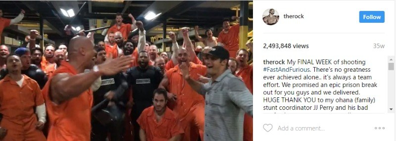 This is a screen shot of the cast of The Fate of the Furious in orange prison jumpsuits.