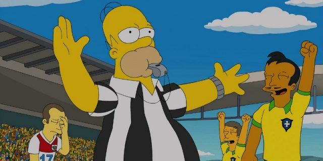 Homer is in a referee uniform and is blowing a whistle on a soccer field.