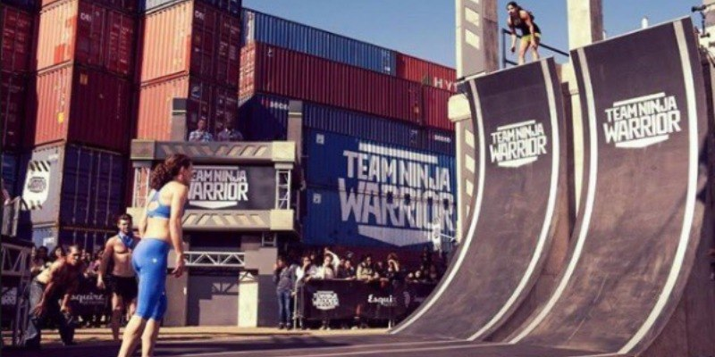 Tiana Webberly is on top of the warped wall looking down at Rose Wetzel.
