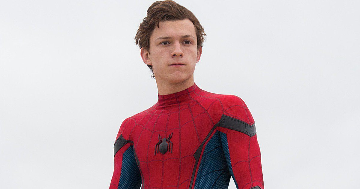Tom Holland posing in a Spider-Man suit