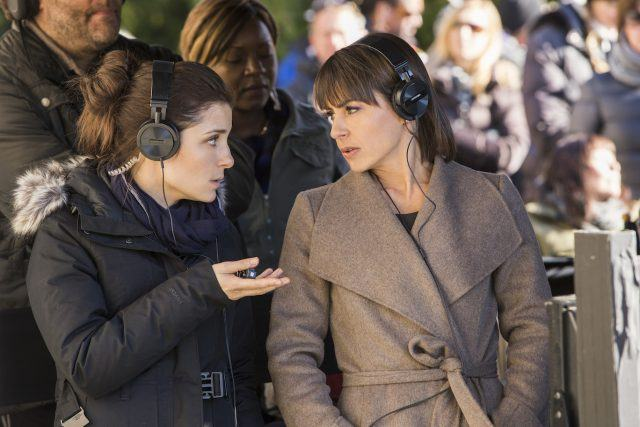 Rachel and Quinn converse while wearing headphones in a scene from the first season of Lifetime's 'UnREAL.'