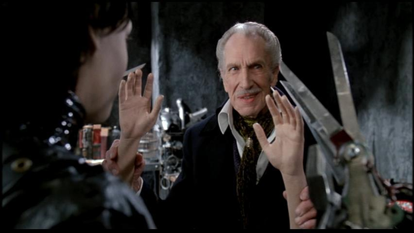 Vincent Price holds up dismembered hands and smiles in Edward Scissorhands