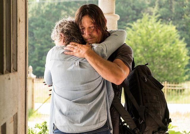 Carol and Daryl embrace in a scene from Season 7 of 'The Walking Dead.'