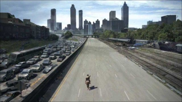 Rick, riding a horse on a deserted highway with Atlanta in the distance in 'The Walking Dead.'