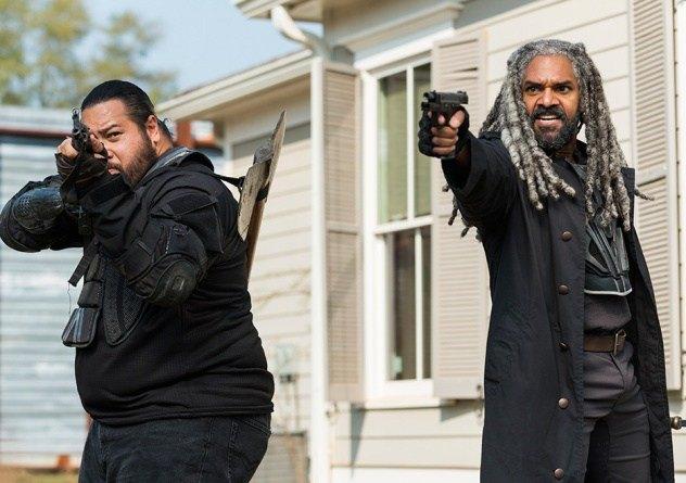 Ezekiel aims his gun in a scene from Season 7 of 'The Walking Dead.'