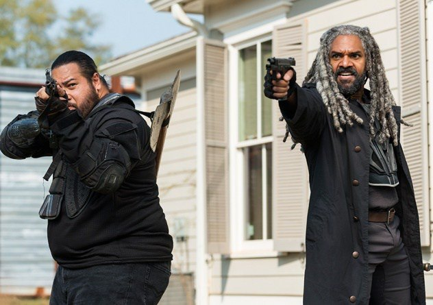 Ezekiel aims his gun in a scene from Season 7 of 'The Walking Dead.'