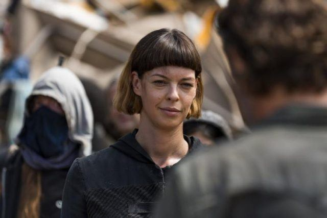 With her allies behind her, Jadis stares Rick down in the junkyard in 'The Walking Dead's seventh season.