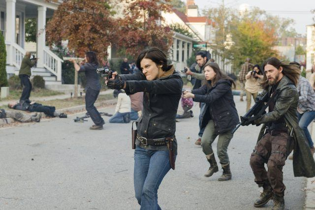 Maggie, Enid and Jesus fire on the Saviors in a scene from the Season 7 finale of 'The Walking Dead.'