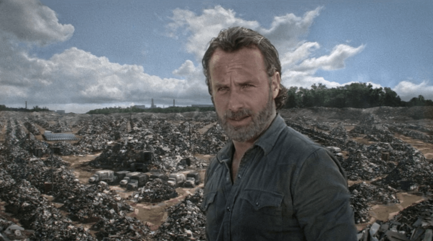 Rick looks at the camera in a field.