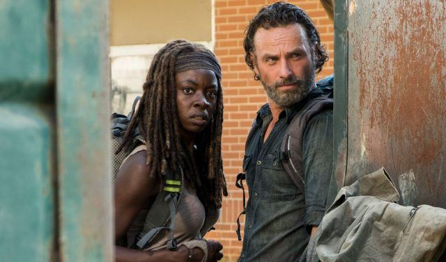 Rick and Michonne looking through a doorway.