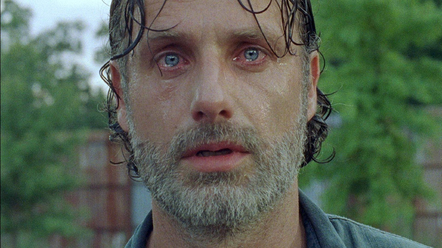 Rick, looking sweaty and disheveled, looks directly into the camera